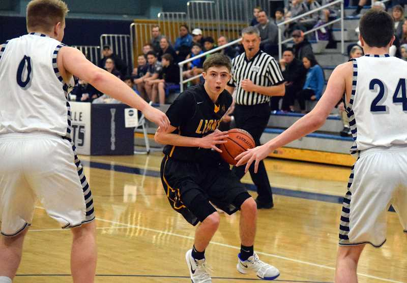 SPOKESMAN PHOTO: TANNER RUSS - Senior Trenton Minich was one of St. Helens top scorers in their 67-49 loss to the Wilsonville Wildcats on Jan. 26.