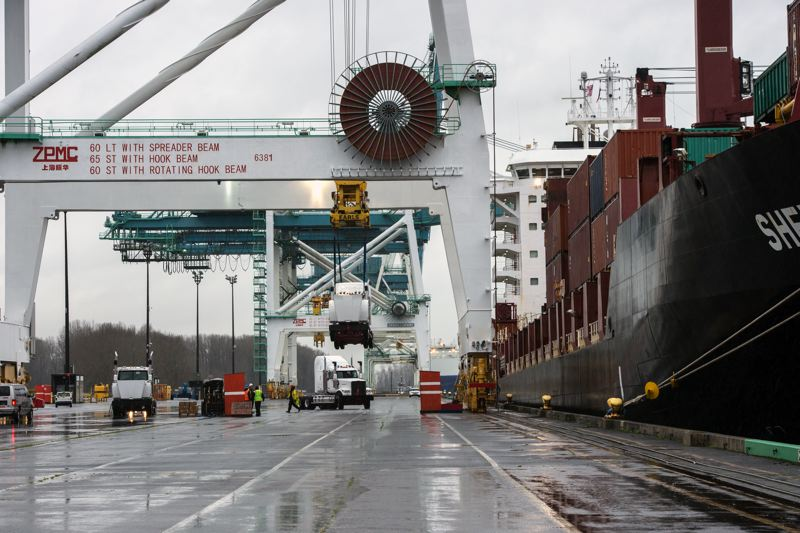 COURTESY: PORT OF PORTLAND - The Shegking dropped off one box but left for Australasia with 77 Western Star trucks and many containers of wood products.