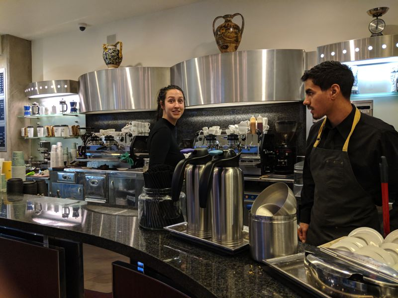 PAMPLIN MEDIA GROUP: JOSEPH GALLIVAN   - Samantha Baltierra and Giancarlo Barone at the Pearl District Caffe Umbria, which is co-owned by Pasquale Madeddu. Madeddu has raised drink and sandwich prices by 25 cents twice in the last year.