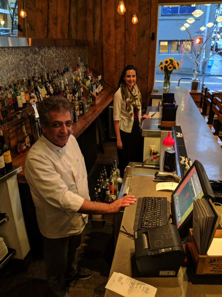 PAMPLIN MEDIA GROUP: JOSEPH GALLIVAN   - Kooroush Shearan, the owner and chef, and Felicia, a server and bar manager, at Piattino, an Italian restaurant at 1140 N.W. Everett St. Shearan has cut staff to pay for wages increases spurred by the advancing state minimum.