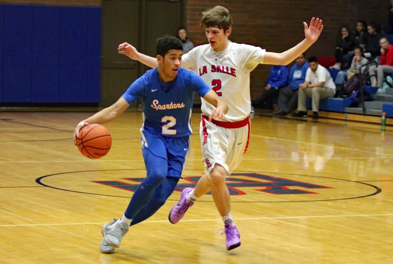 REVIEW/NEWS PHOTO: JIM BESEDA - Hillsboro's Quintin Thomas (left) pushes the ball past La Salle Prep's Jace Norton during the second quarter of Friday's Northwest Oregon Conference boys' basketball game at La Salle.