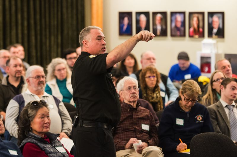 STAFF PHOTO: CHRISTOPHER OERTELL - Forest Grove Fire & Rescue Chief Michael Kinkade shows the audience at a well-attended Saturday meeting in Forest Grove a presentation on fire services.