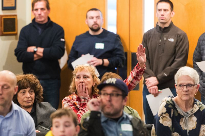 STAFF PHOTO: CHRISTOPHER OERTELL - Some attendees at Forest Grove's annual town meeting had questions for city staff, especially Fire Chief Michael Kinkade, who laid out the idea of a Western Washington County Fire Authority that would encompass the Forest Grove, Cornelius and Gaston areas.