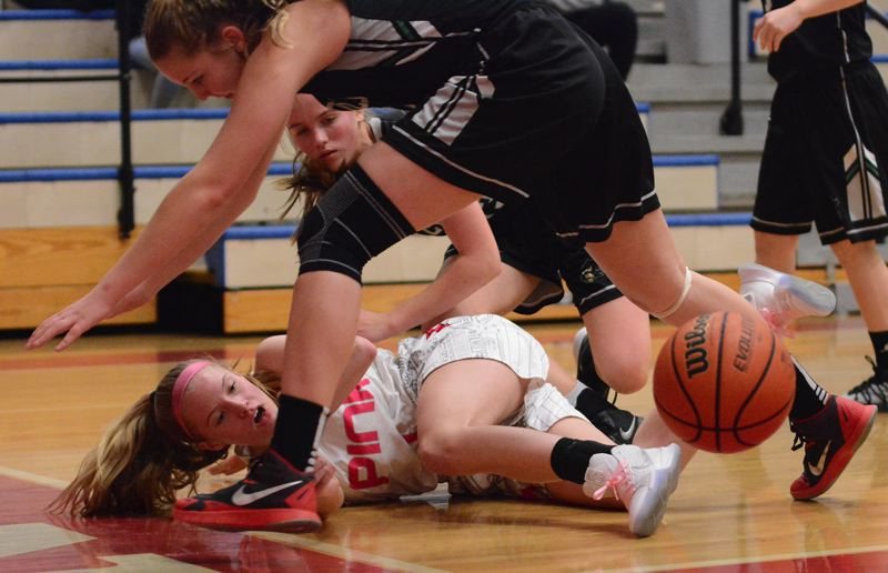 OUTLOOK PHOTO: DAVID BALL - Centennial's Ellie Basinski (here trying to save a loose ball) would score a game-high 11 points in the Eagles' 55-21 win over Reynolds.