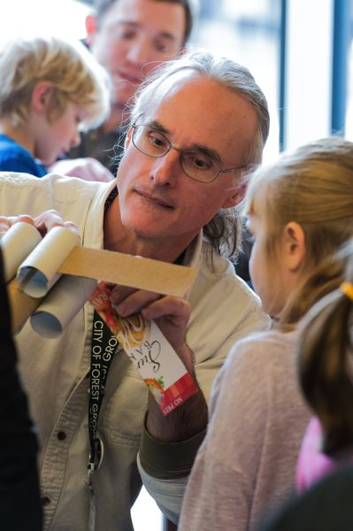 STAFF PHOTO: CHRISTOPHER OERTELL - Forest Grove City Library employee Jim Jatkevicius helps to make an X-wing fighter out of cardboard during Saturdays Be a Library Jedi event.