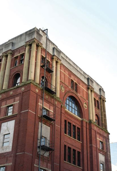 PAMPLIN MEDIA GROUP FILE PHOTO - The Ancient Order of United Workmen building at Southwest Second and Taylor was just one of Portland's many unreinforced masonry buildings. The costs to rennovate this building were deemed too costly and it succumbed to the wrecking ball.
