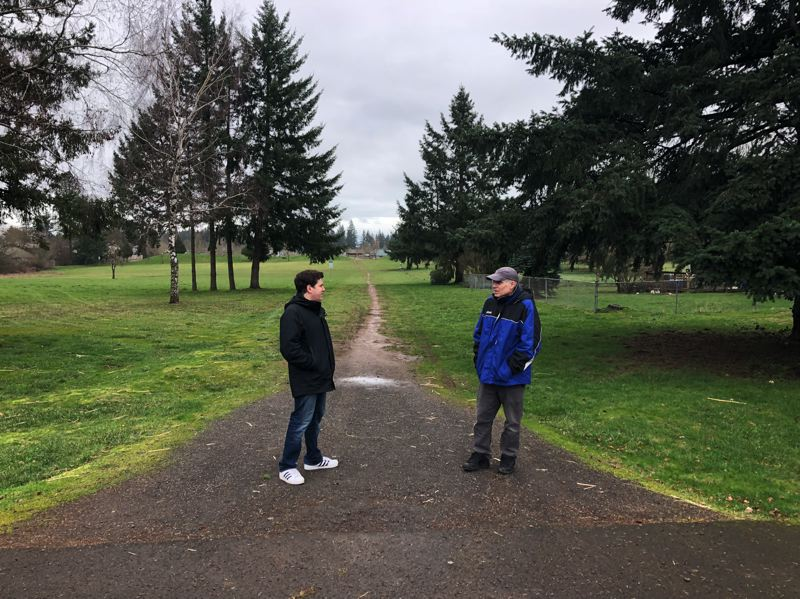 SUBMITTED PHOTO - Philip and David Abraham survey the area of the proposed development at Wesley Lynn Park in Oregon City.