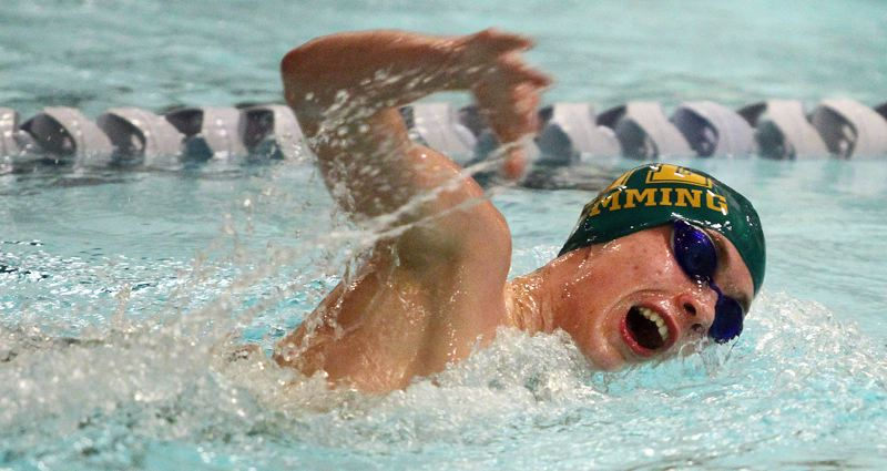 TIDINGS PHOTO: MILES VANCE - West Linn freshman Nathan Rumsey (shown here against Lakeridge) won the 500-yard freestyle against Tigard last week.