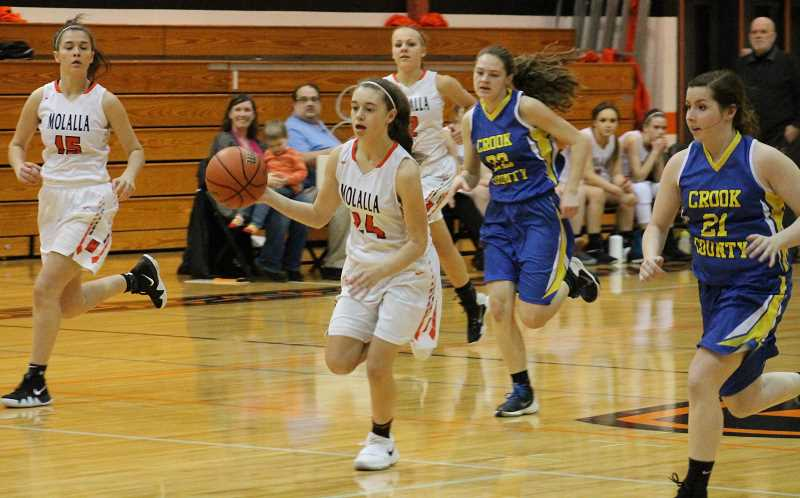PIONEER PHOTO: CONNER WILLIAMS - Molalla freshman Zoe Wood (24) makes her way down the court during the Indians 63-27 win over Crook County last Tuesday.