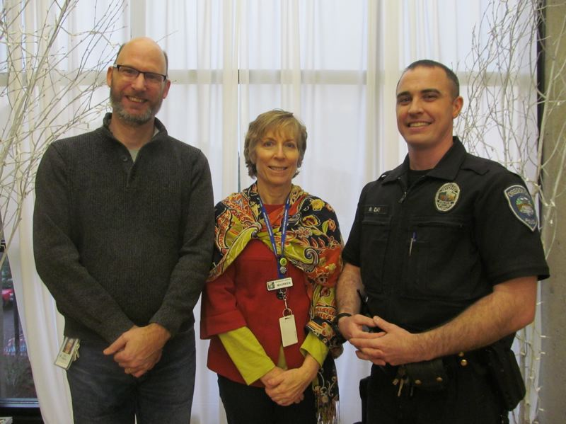 PHOTO BY ELLEN SPITALERI - From left, Eric Kilgore, tech specialist at New Urban High School; Maureen Cole, Oregon City Library director; and Mike Day, homeless liaison for the OC Police Department, were the three newest recipients of donations from the Oregon City Womans Club.