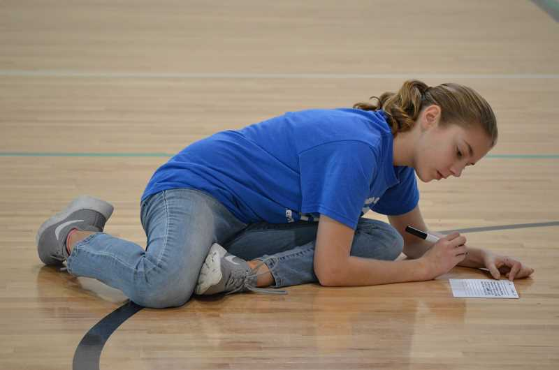SPOKESMAN PHOTO: CLARA HOWELL  - Sixth-grader Lily Scanlan takes part in an activity to become a student leader.