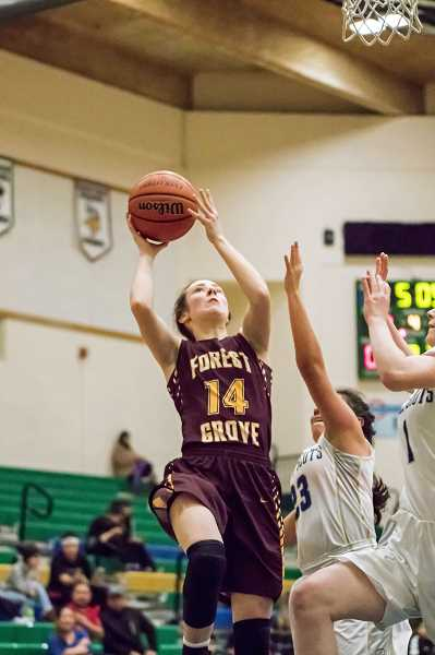NEWS-TIMES PHOTO: WADE EVANSON - Forest Grove's Emily Huson attempts a shot during the Vikings' game against McKay at McKay High School.