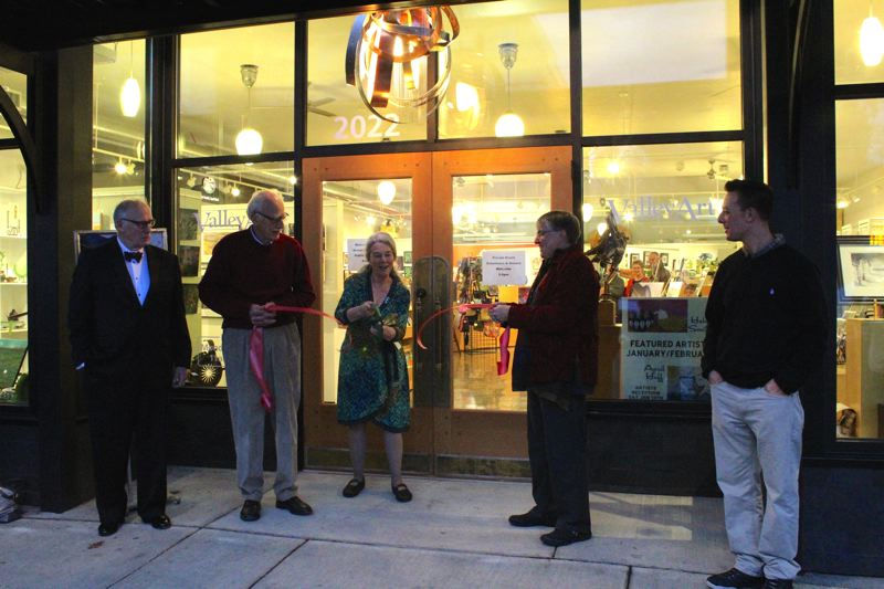 STAFF PHOTO: MARK MILLER - From left, Forest Grove Mayor Pete Truax, Valley Art Association interim treasurer Lynne Magner, Valley Art president Jeanne Leavy, Valley Art board member Jerry Hoerber and Matt Stone of the Forest Grove/Cornelius Chamber of Commerce cut the ribbon in front of Valley Art Gallerys remodeled storefront on Main Street.
