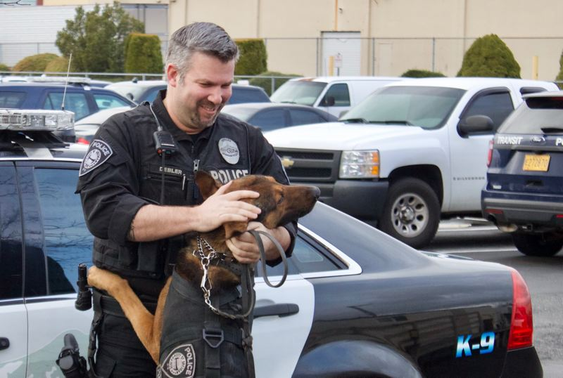 OUTLOOK PHOTO: CHRISTOPHER KEIZUR - Officer Shawn Debler said he spends more time with Basco than he does with his own family.