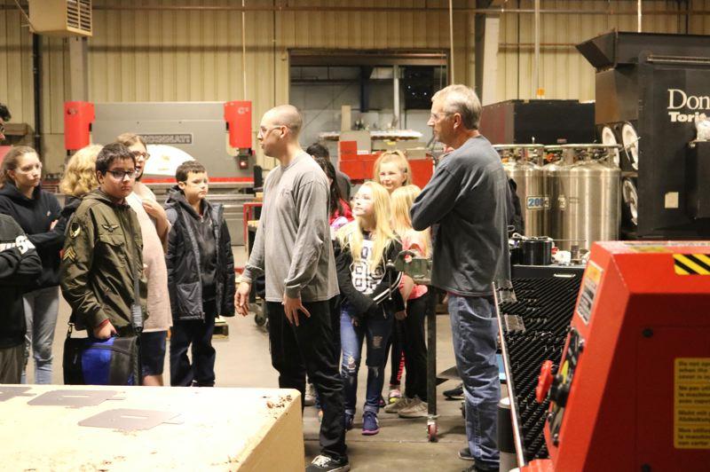 OUTLOOK PHOTO: ZANE SPARLING - Clear Creek Middle School students take a tour of Advanced Metal & Wire Products in Wood Village on Wednesday, Jan. 24.