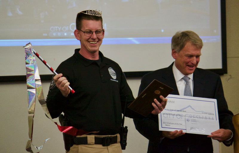 OUTLOOK PHOTO: CHRISTOPHER KEIZUR - Gresham Police Departments Sgt. Ted VanBeek holds the honory tiara and scepter, given to the city Employee of the Year.