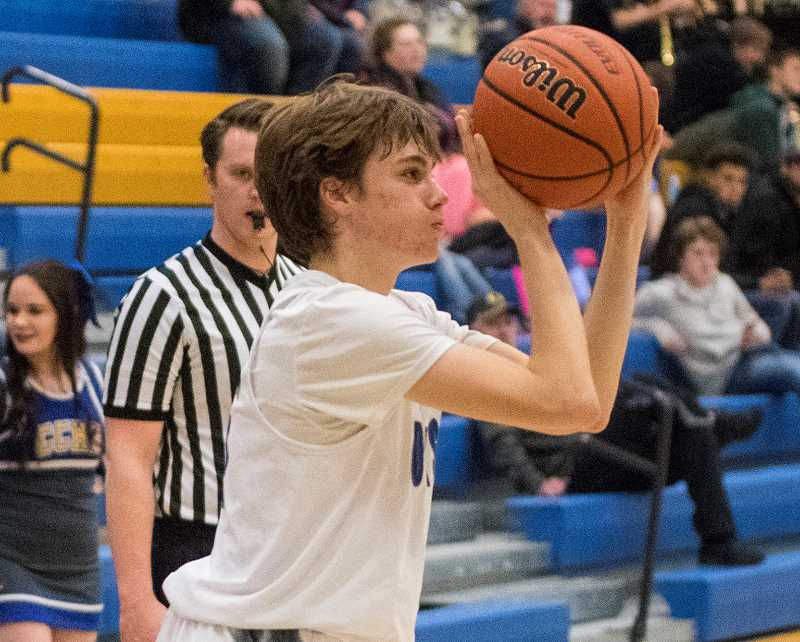 LON AUSTIN/CENTRAL OREGONIAN - Shane Kessi goes up for a jumper at a home game earlier this year. Kessi scored eight points on Saturday, including hitting a pair of 3-pointers in Crook County's 45-39 loss to Gladstone.