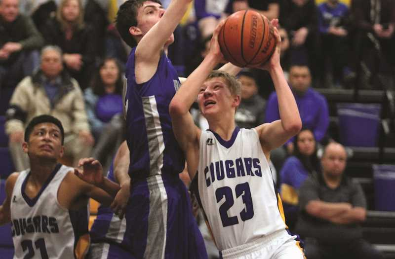 PHIL HAWKINS - Gervais senior Nicola Zharkoff contributed 22 points and 14 rebounds for the Cougars in the team's Friday night victory over the Chemawa Braves.