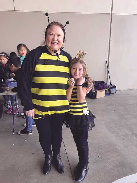 COURTESY PHOTO: HERITAGE ELEMENTARY - Heritage celebrated Kindness Week with a spirit week, with Thursday being Be Kind Day, allowing staff and students, like Counselor Rita McClellan and third-grader Olivia Garman, to dress up as bees.