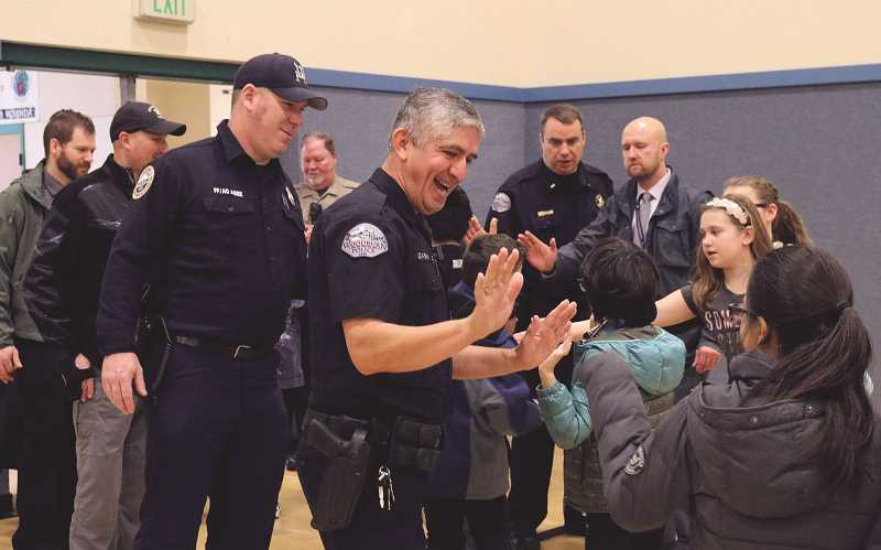 COURTESY PHOTO: CITY OF WOODBURN - Schools participating in the Great Kindness Challenge invited community groups to come in and greet students in the morning last week, including Woodburn police officers and firefighters at Heritage Elementary.