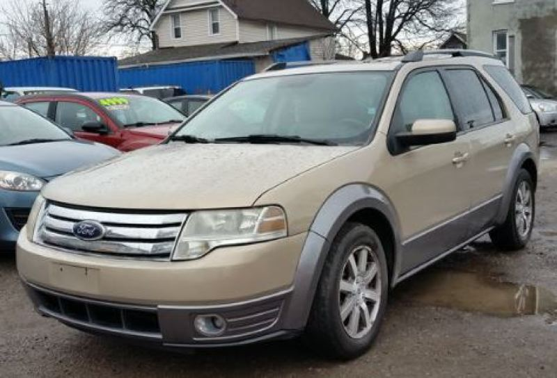 CONTRIBUTED: GRESHAM POLICE DEPARTMENT - Gresham Police are searching for a tan 2008 Ford Taurus X with Oregon license plate 141HXP after it was stolen during a home invasion.