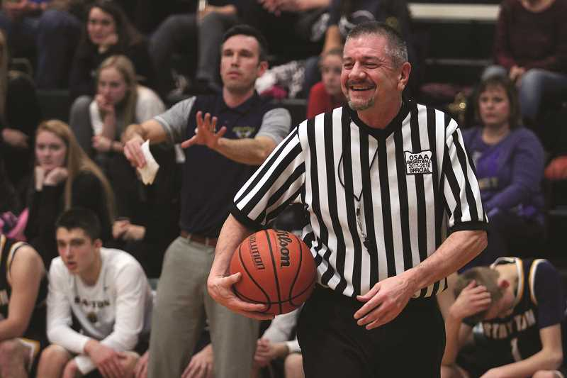PHIL HAWKINS - A basketball official pauses during the North Marion boys basketball game versus Stayton Friday. Referee shortages have affected local teams this season, including North Marion, whose games last week had to be rescheduled due to lack of officials.