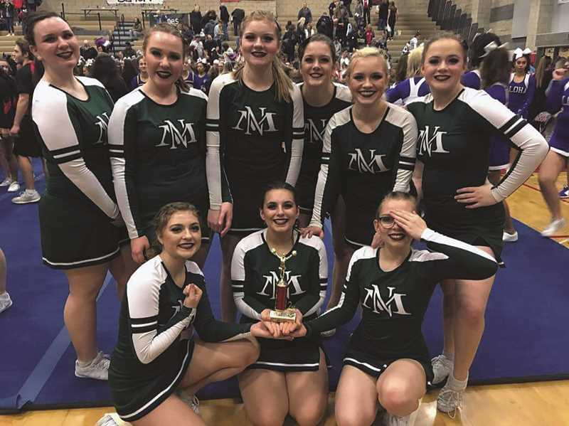 NORTH MARION CHEER - The North Marion cheer team celebrates after placing second at the Cavalier Invitational on Saturday.