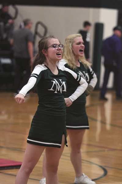 PHIL HAWKINS - The North Marion cheer team practiced their routine at halftime of the school's home girls basketball game on Friday.