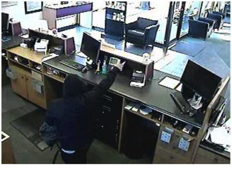PHOTO COURTESY OF FBI - A man suspected of being the 'froggy robber' wanted in connection with five robberies in Oregon since November, is caught on surveillance camera at the US Bank in Scappoose. The suspect remains at large.