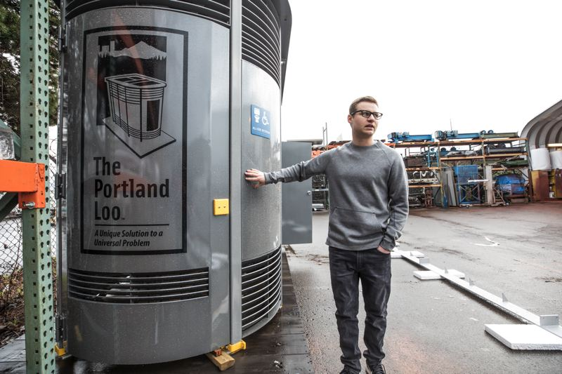 PORTLAND TRIBUNE: JONATHAN HOUSE - Evan Madden, Portland Loo sales manager for Madden Fabrication, explains the features of one headed for Miami at his family-oswned business in Northwest Portland.
