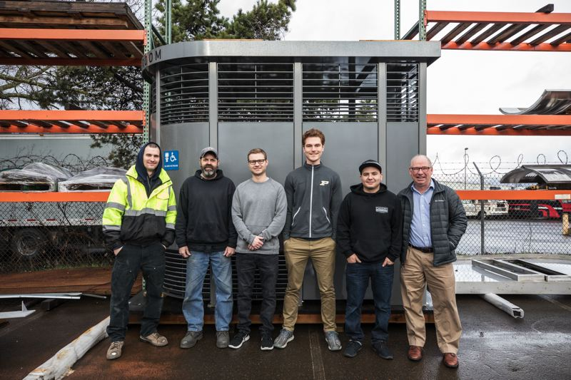 PORTLAND TRIBUNE: JONATHAN HOUSE - The Madden Fabrication team in front of a completed Portland Loo. Greg Madden is on the right.
