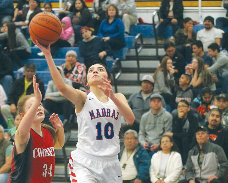 WILL DENNER/MADRAS PIONEER - Annie Whipple (10) attempts a layup against Corbett's Sydney Smith during the third quarter of Friday's game.