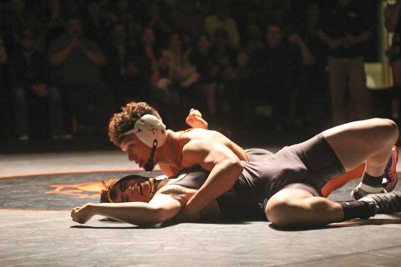 WILL DENNER/MADRAS PIONEER - In the 152-pound match of last Wednesday's Cowdog Classic in Culver, Victor Torres pinned Crook County's Trevor Martin in 2:48, giving the Bulldogs a 10-8 lead four matches into the dual.