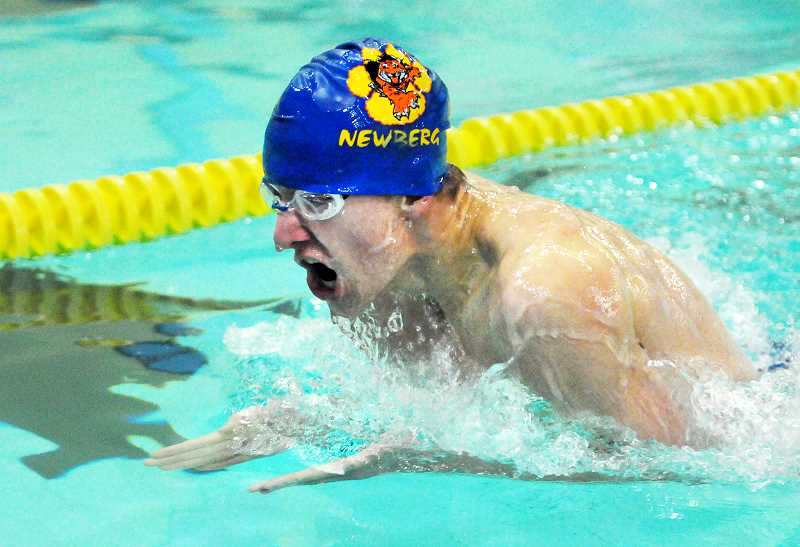 SETH GORDON - Raleigh Day comes up for air during the 100 breaststroke during Newberg's 98-71 home win over Lakeridge Jan. 25. Day placed second in 1:10.27.
