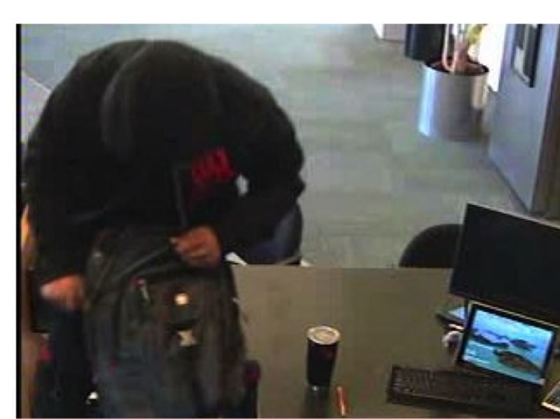 FBI PHOTO - A man believed to be the 'froggy robber' places a backpack on a US Bank counter in Scappoose Tuesday morning, Jan. 30 during a robbery.