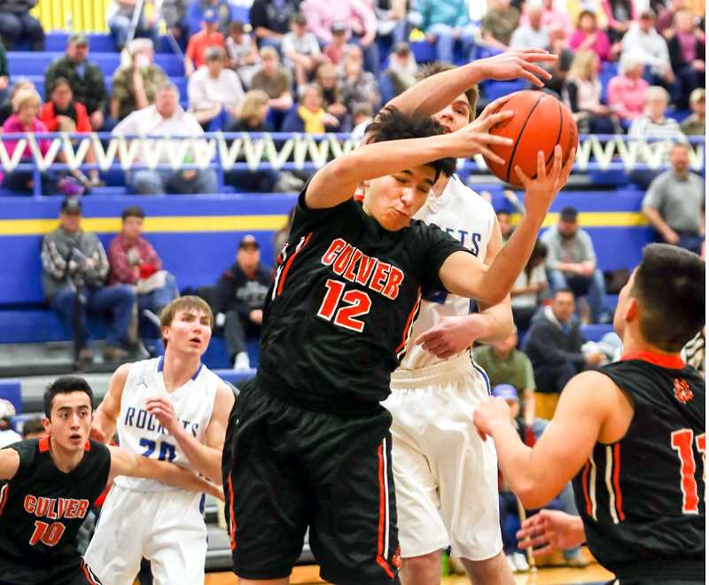 KATHY ANEY/FOR THE PIONEER - Culver's Eduardo Gutierrez (12) grabs a rebound during Saturday's game against Pilot Rock.