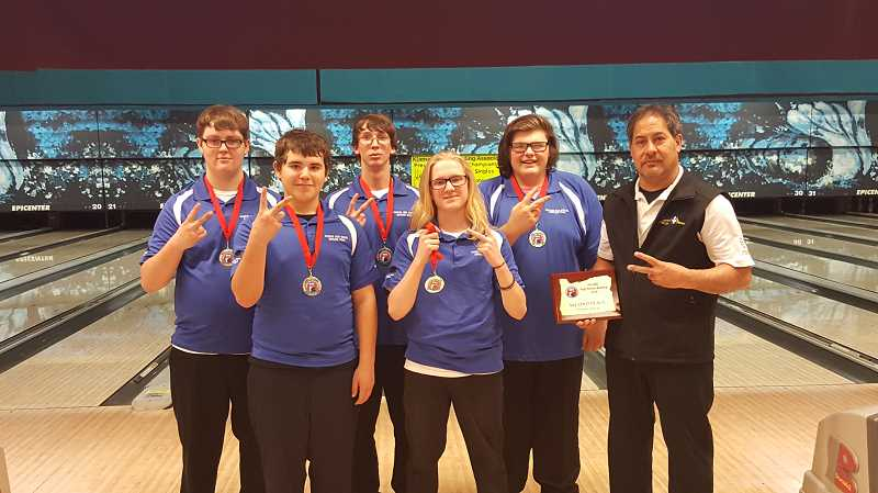 PHOTO COURTESY OF TAMI KEPAA - The Madras High boys bowling team took second at the District 6 Tournament on Sunday in Klamath Falls and punched their ticket to state. Standing from left to right are Garrett Goelze, Bobbie Letlow, Jordan Lamb, AJ Morgan, Andrew Short and coach Kalani Kepaa. The team is a co-op between Madras, Culver and Redmond.