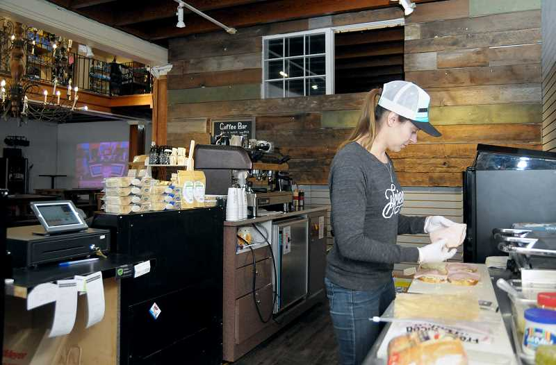 GARY ALLEN - Robin Sikkens prepares a healthy sandwich from Social Goods' new café menu, whose products are locally sourced and are either organic or from a nearby farm.