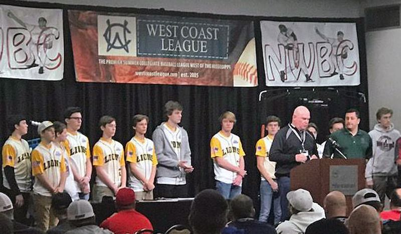 SUBMITTED PHOTO - West Linn Babe Ruth coach Ray Pearson, flanked by assistant coach Rob Hoover and the team, addresses a packed house of over 200 baseball coaches, including Pat Casey from the Oregon State Beavers and George Horton from the Oregon Ducks on Jan. 20.
