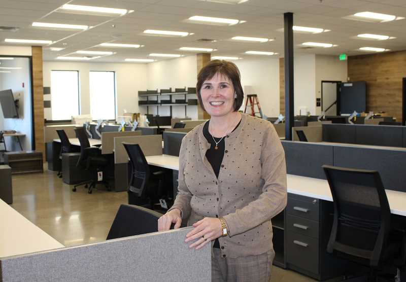 HOLLY M. GILL - Laura Crocker, media director for KEITH Manufacturing, stands in the open office area on the main floor of the new two-story, 12,454-square-foot building.