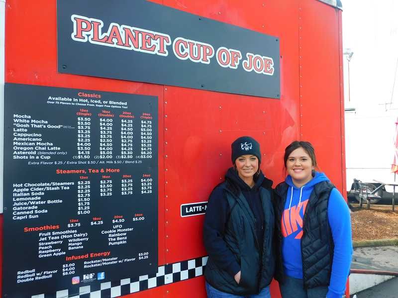 ESTACADA NEWS PHOTO: EMILY LINDSTRAND - Planet Cup of Joe owner Leanne Van Winkle (left) is back at the coffee stand after taking time away to care for her daughter.