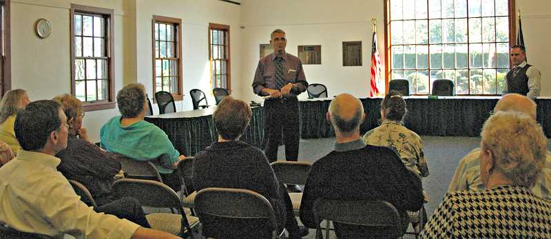 FILE PHOTO - Kennemer addresses a crowd at Estacada City Hall.