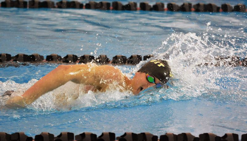 TIMES PHOTO: MATT SINGLEDECKER - Jesuit junior Trent Martinez is a marvel in both the 200 and 500-yard freestyle races for the Crusaders.