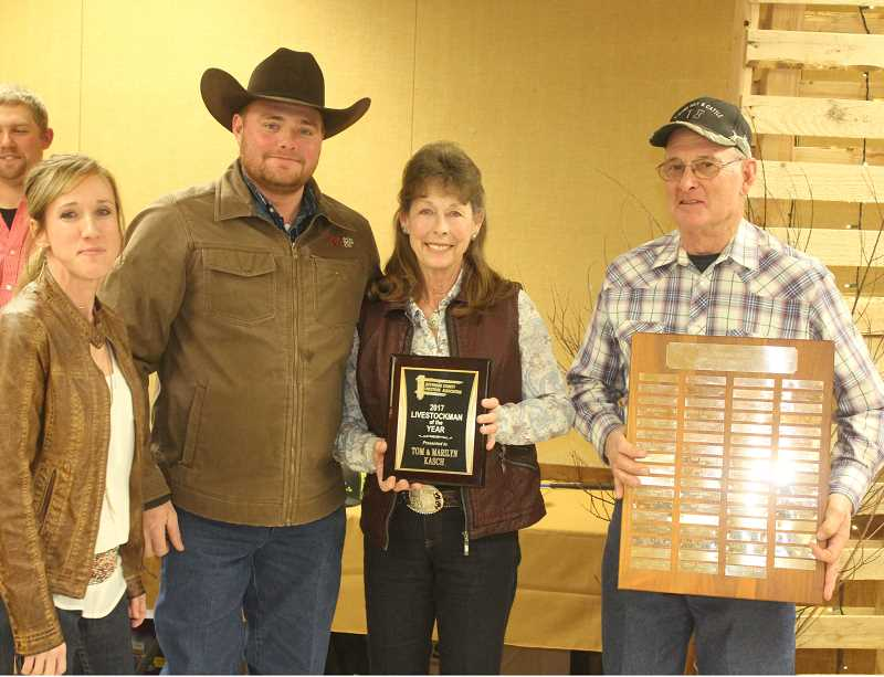 SUSAN MATHENY/MADRAS PIONEER - Sammee and Tommy Green, on left, present the Livestockman of the Year Award to ranchers Marilyn and Tom Kasch.