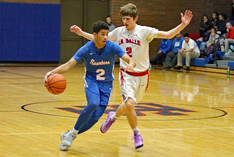 PAMPLIN MEDIA PHOTO: JIM BESEDA - Hilhi's Quintin Thomas dribbles around a La Salle defender during the Spartans' game against the Falcons Jan. 26 at La Salle Prep.