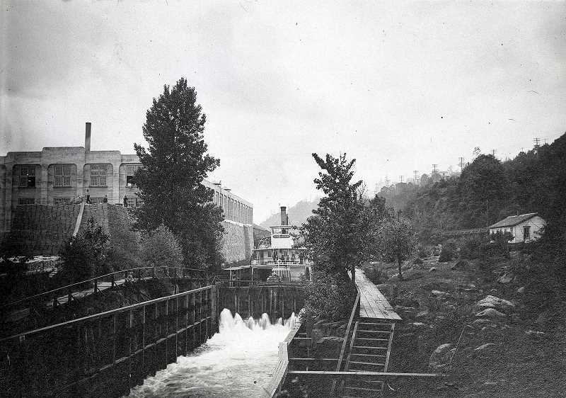 COURTESY CLACKAMAS COUNTY HISTORICAL SOCIETY - The Oregona steamship travels through the Willamette Falls Locks in 1908. The large building visible on the left is the Willamette Paper Mill.