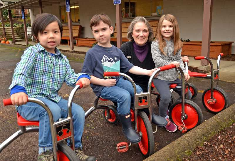 TIDINGS PHOTOS: VERN UYETAKE - West Preschool teacher Cathy Vause with students, from left, Bae Brown, Leo Kelly and Ashlyn Alvarado, all three who have a parent that Vause had taught at the preschool.