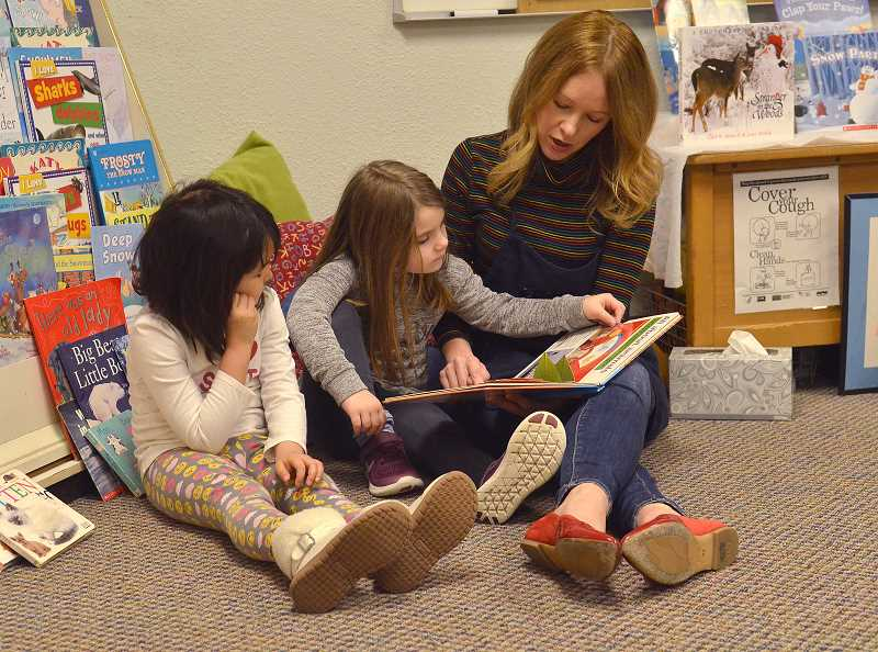 Carly Bockorick reads to Lexi Galla, left, and Ashlyn Alvarado.