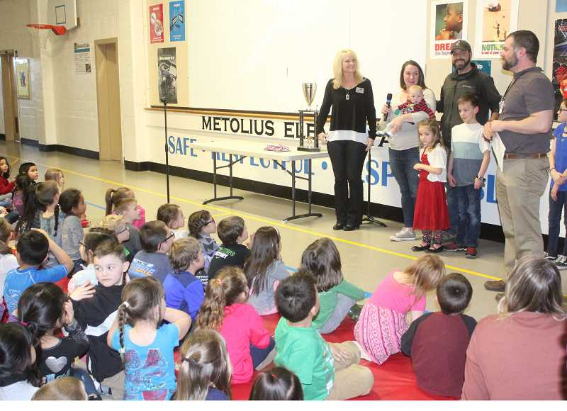 SUSAN MATHENY/MADRAS PIONEER - Metolius Principal Adam Dietrich introduces the students to the family and Sparrow Director Nancy Childers, on left.
