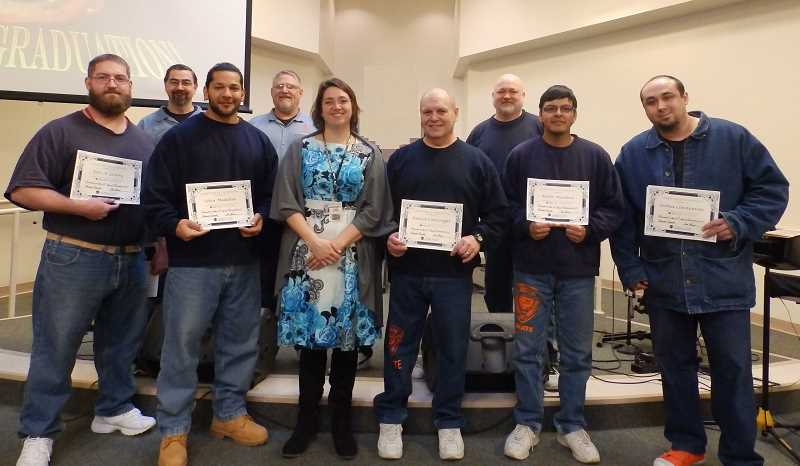SUBMITTED PHOTO - Inmate graduates from the Jobs for Life program posing with their certificates are, from back left, Alvin , Bill, Fletch. Front row, Eric, Selva, instructor Charitie Gamble, Patrick, Adolfo, and Joshua.